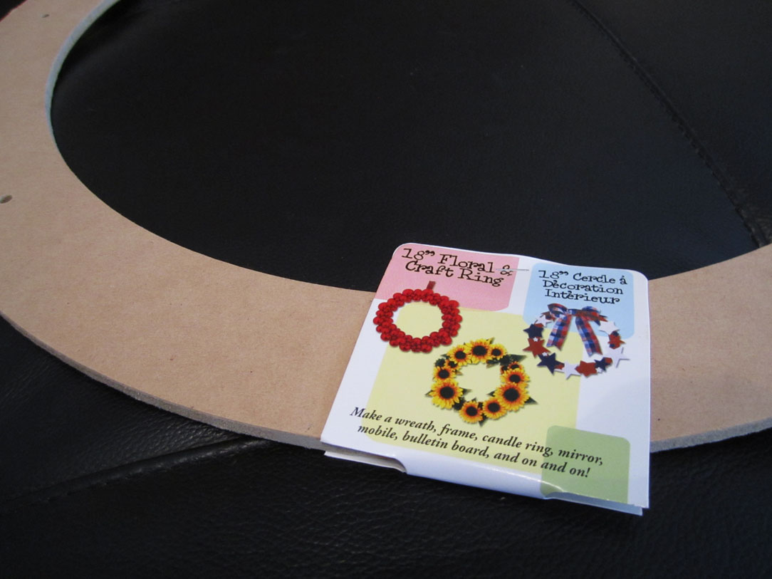 A blank wooden wreath frame on the table.