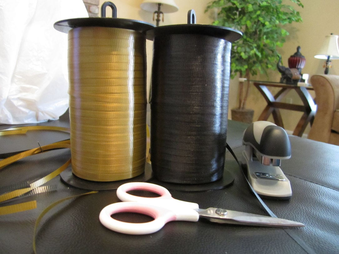 Black and yellow ribbon with scissors on the table.