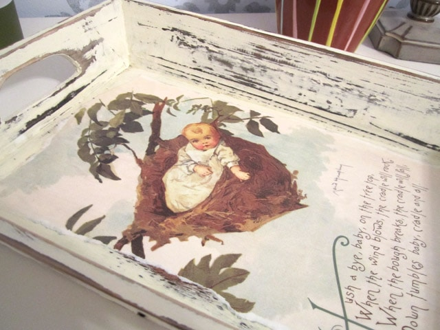 A vintage looking tray with a nursery rhyme on it.
