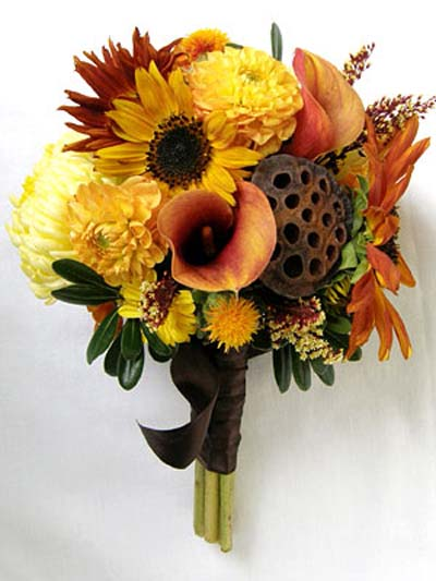 Bouquet of yellow, gold, red flowers.