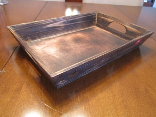 Wooden tray on the table.