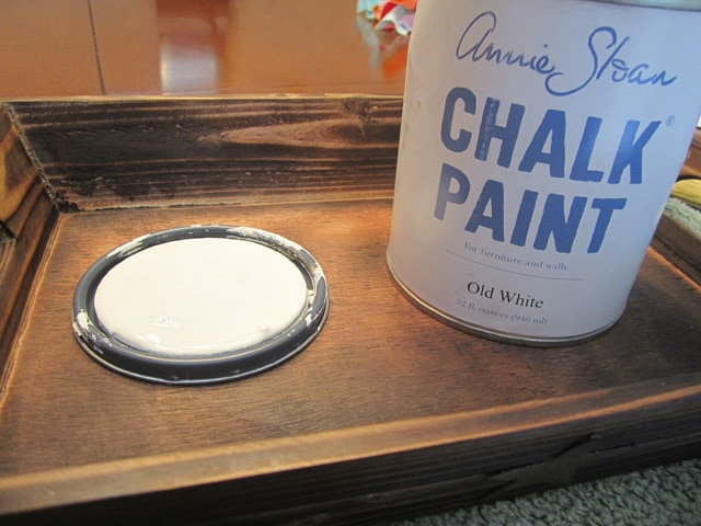 A can of Annie Sloan Chalk Paint on the table beside the tray.