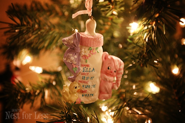 A baby bottle ornament on the tree.