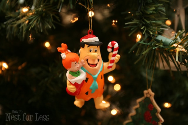 Fred Flintstone holiday ornament hanging on the Christmas tree.
