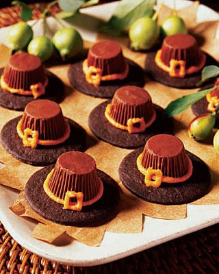 Candy chocolate pilgrim hats on a plate.