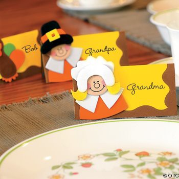 Little pilgrim placecards on the table.