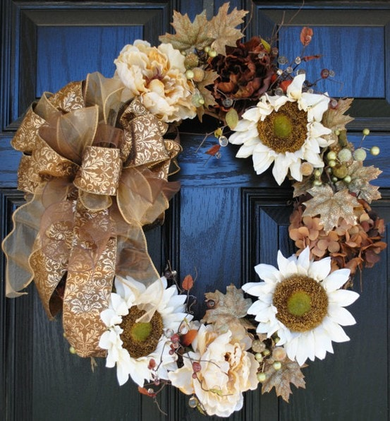 A white, gold, and amber holiday wreath on the door.