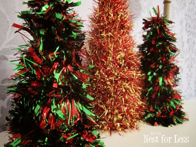 Red, green, and red and gold mini trees.