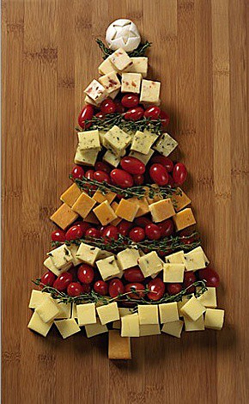 A veggie and cheese tray in the shape of a Christmas tree.