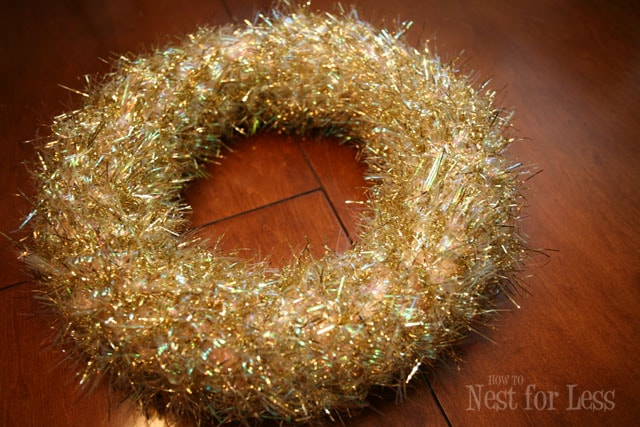 The gold tinsel all around the wreath, sparkly.