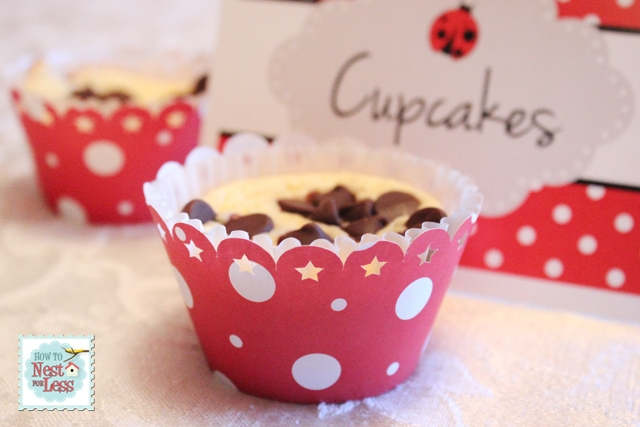 Chocolate chip cupcakes in a red and white dotted cupcake holder.