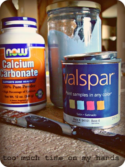 Paint in a can and in a jar plus calcium carbonate powder in a plastic container.