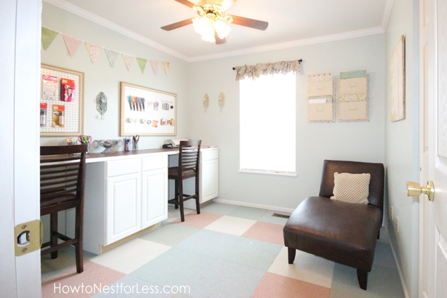 Craft room, with brown lounger in corner and window.
