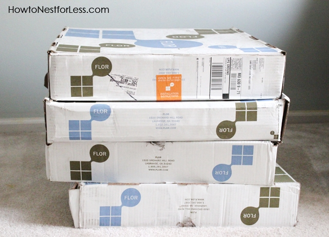 Boxes of the Flor tiles stacked on top of each other.