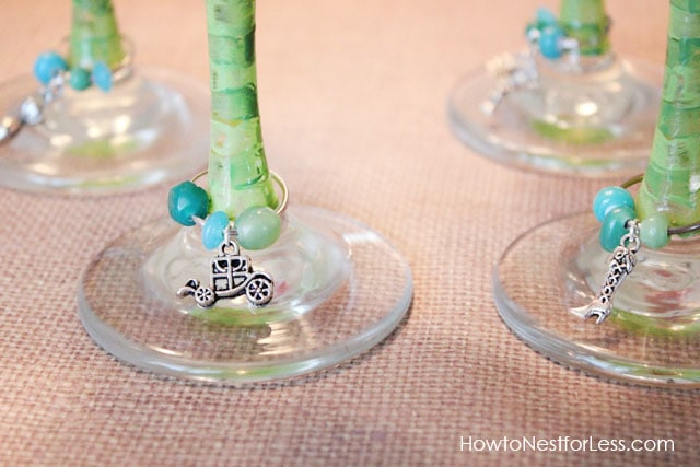 The charms around the stem of the wine glass.
