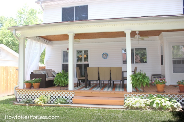 Backyard porch makeover how to nest for less for Covered back porch plans