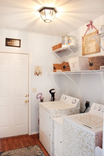 Stenciled washer and dryer in painted laundry room.