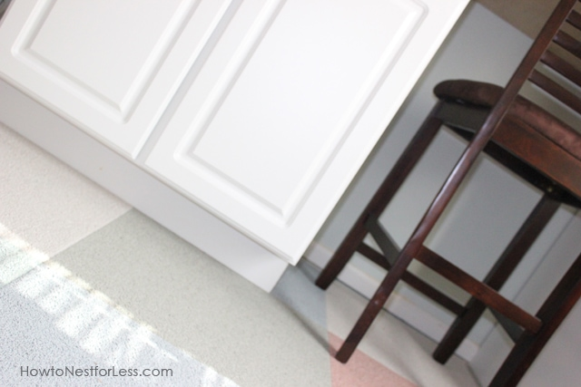 Adding the white trim to the bottom of the desk and a brown chair near it.