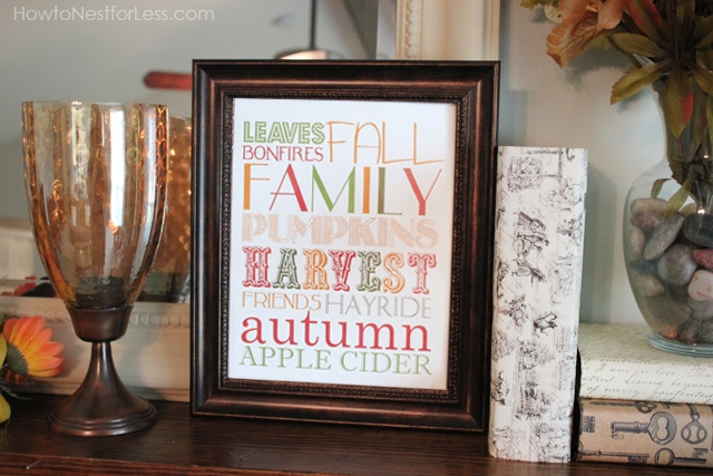 Fall family harvest saying in a picture frame on the mantel.
