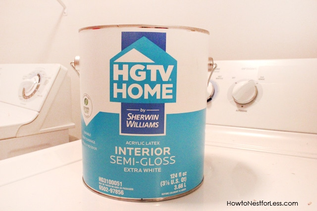 A can of interior semi glass HGTV paint on the washing machine.