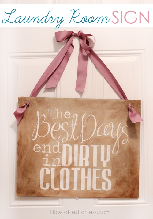 The Best Days laundry sign with a pink ribbon hanging on the door.