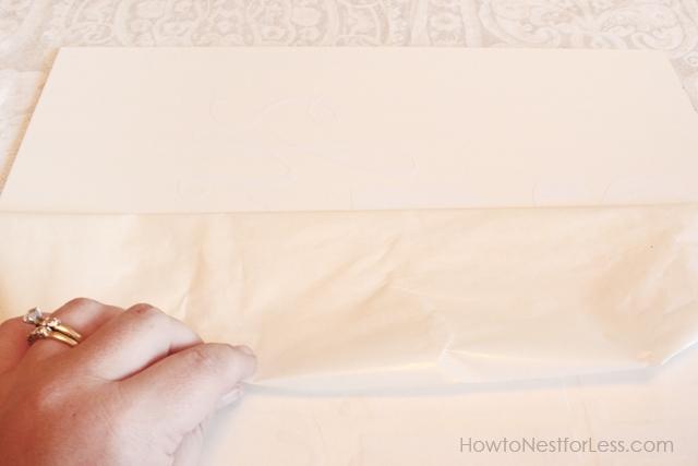 Peeling off the wrapper on the artist board.