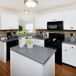 white kitchen cabinets black appliances