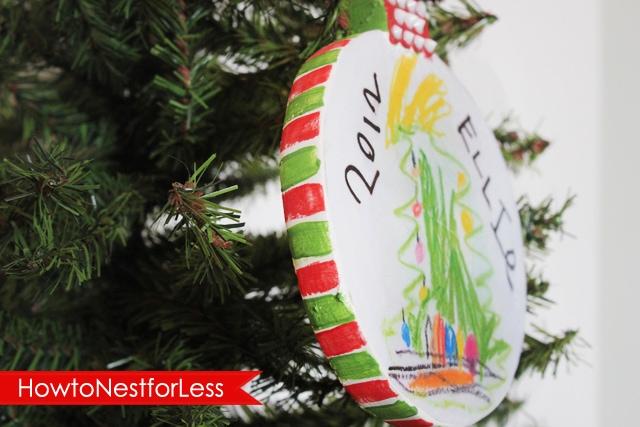 The kids Art Christmas ornament hanging on the Christmas tree.