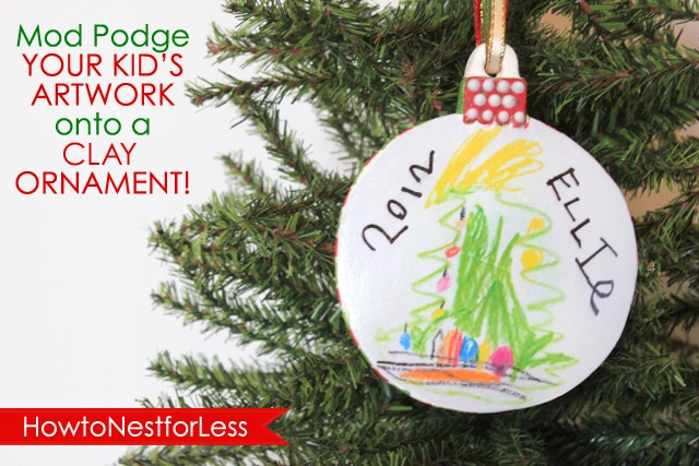A handmade Christmas ornament hanging on a Christmas tree.
