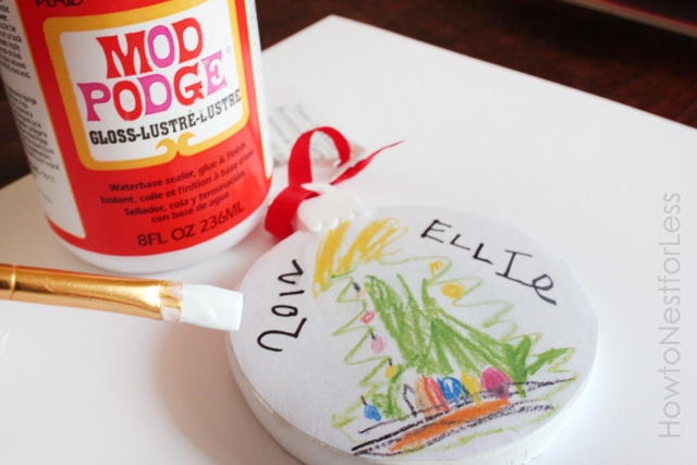 Mod Podge, and art brush and the ornament art.
