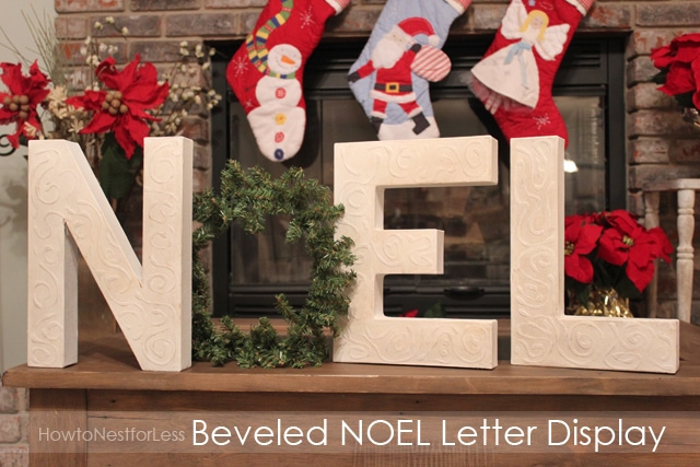 Noel sign on the mantel with Christmas stockings hanging above it.