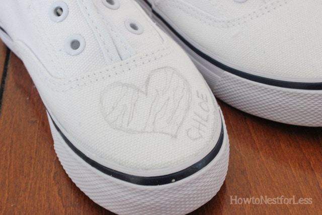 Putting the design on the shoes in pencil first.