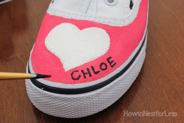 A white heart and a little girl's name Chloe on the shoe.