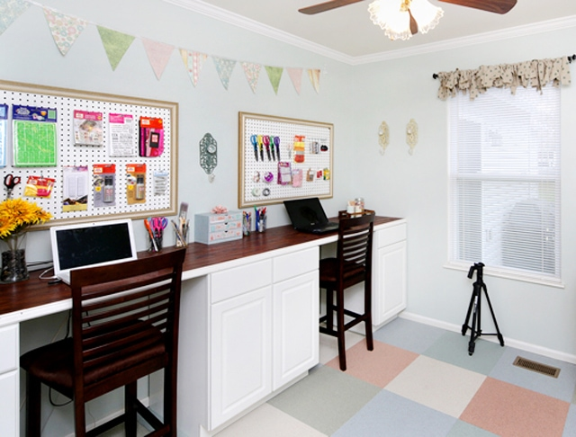 Craft room with desk and ceiling fan.