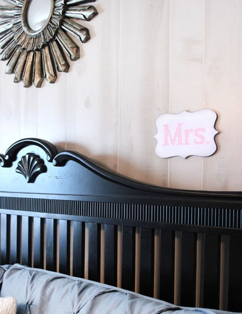 mr and mrs wood cut out above bed