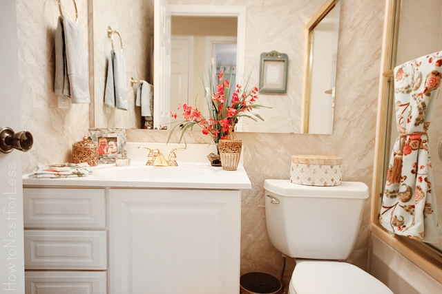 Guest bathroom makeover how to nest for less for Pink and gold bathroom accessories