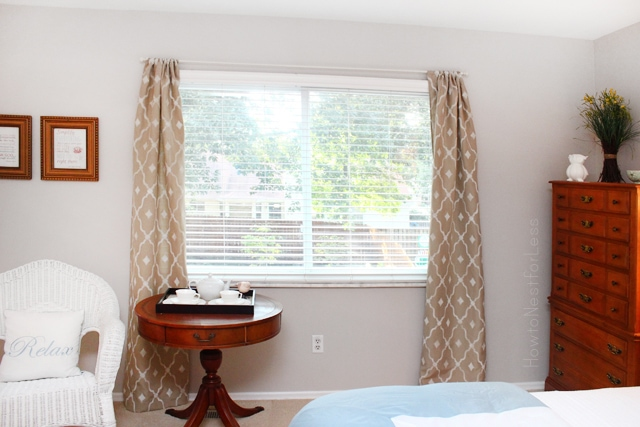 Stenciled brown and white curtains in the bedroom.