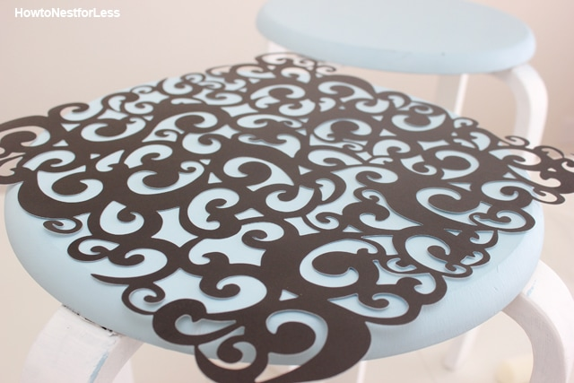 Lining up the stencil on the stool.
