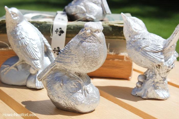 silver metallic spray painted birds