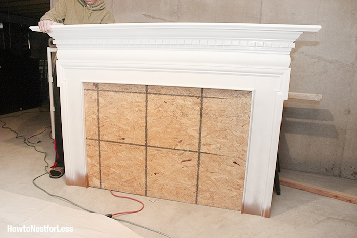 white fireplace mantel headboard