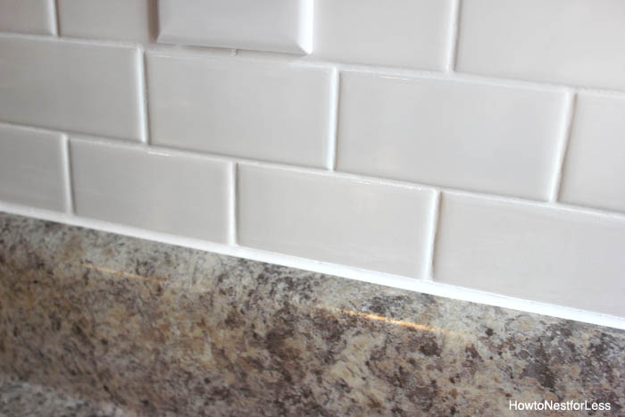 caulk white subway tile backsplash tutorial
