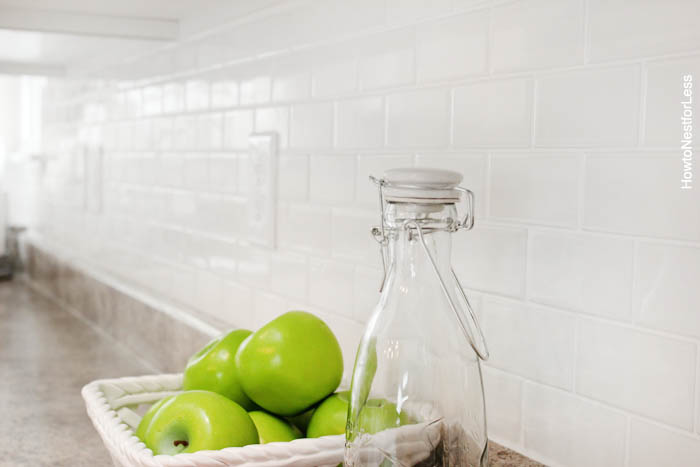 white tile kitchen backsplash