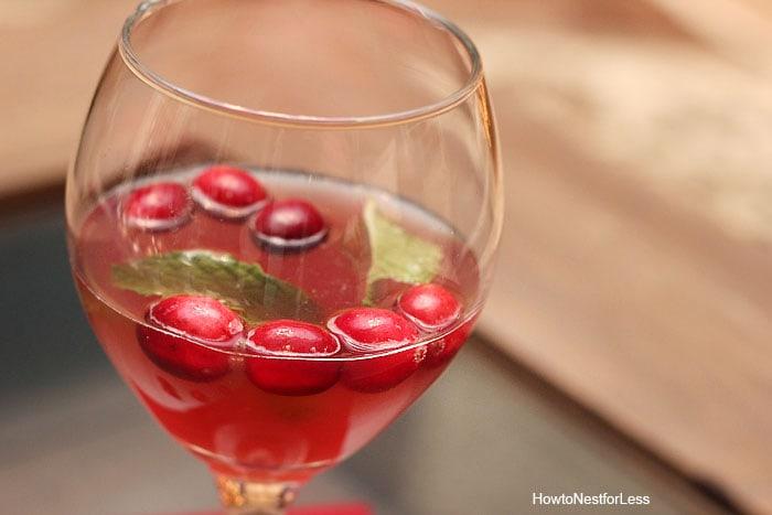 Jingle juice christmas drink with a mint leaf floating inside it.