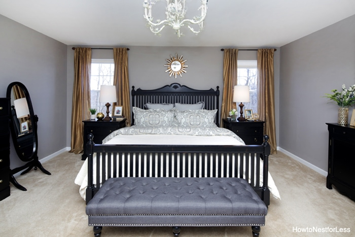 Grey charcoal bench at the foot of the bed.