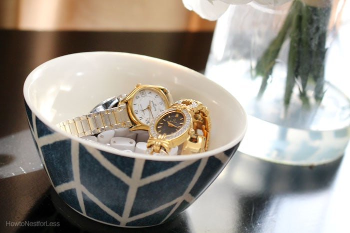 Gold watches on nightstand.