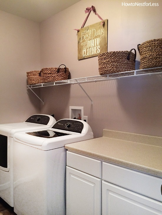 laundry room shelves and sign