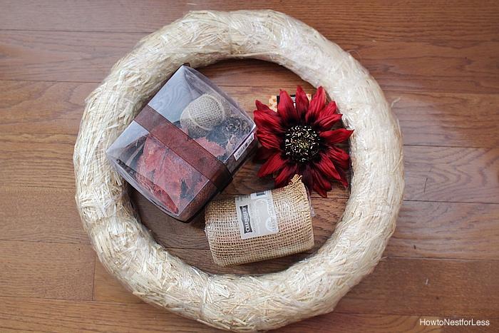 Fall burlap wreath supplies on the floor.