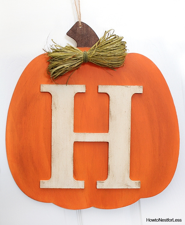 Orange pumpkin with the H monogram in white on it.