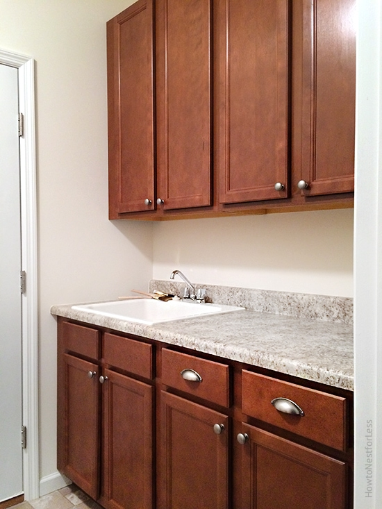 laundry room utility sink and cabinets