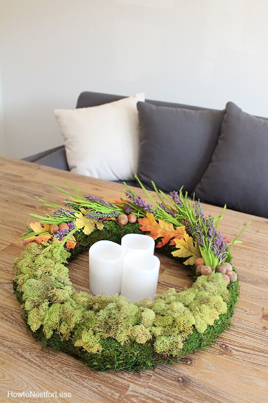 Moss centrepiece on wooden coffee table.